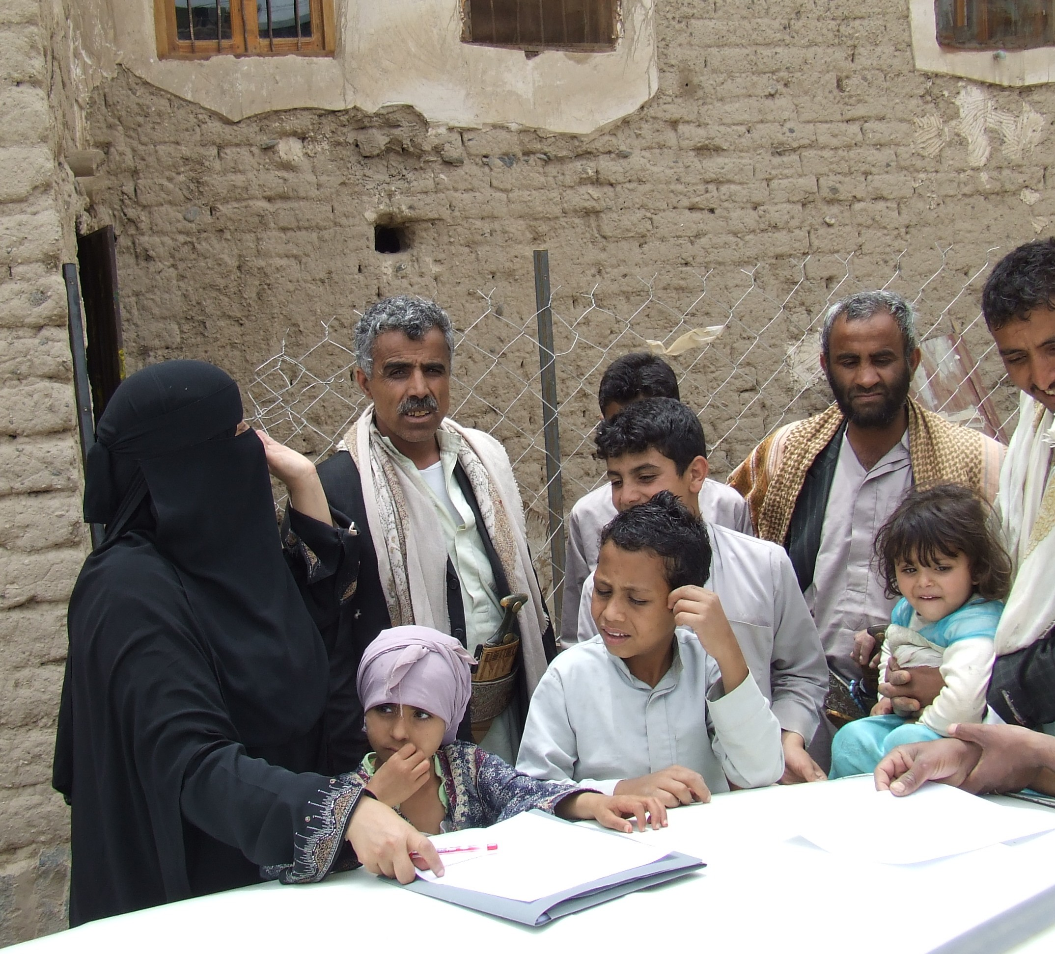 yemeni woman writing + kids.jpg